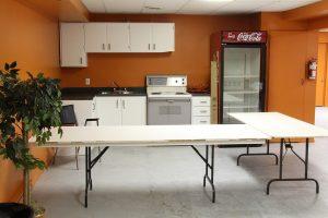 Salle au sous-sol avec cuisinette quilles st-gregoire